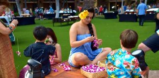 Keiko are shown how to make leis at the Ka Wa'a Luau at the Aulani, A Disney Resort and Spa