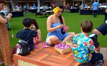 Keiko are shown how to make leis at the Ka Wa'a Luau at the Aulani, A Disney Resort and Spa