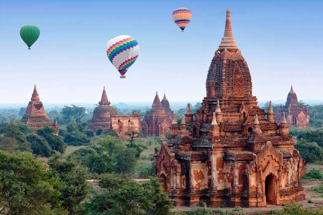 Travel in Myanmar. Hot air balloons soar over the Bagan Temples in Myanmar. Credit ZZvet@dreamstime.com.jpg