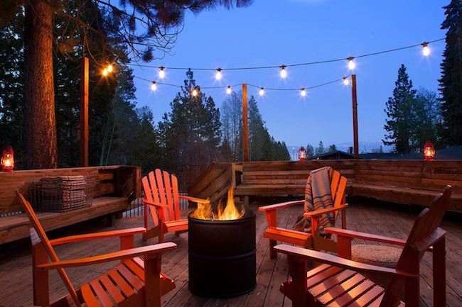 Fire pit on upper deck. Photo courtesy of Basecamp Hotels