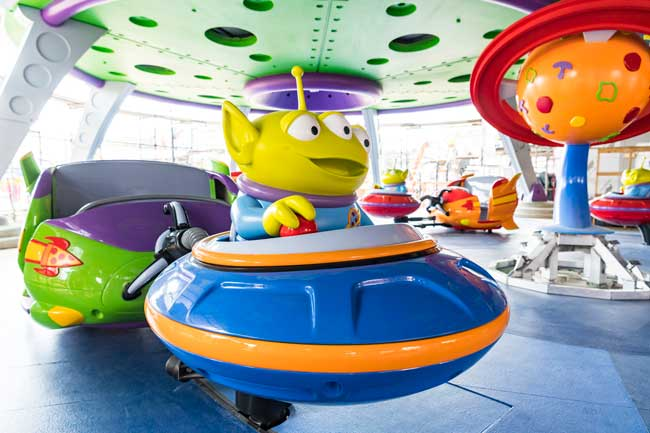 Alien Swirling Saucers spins riders in toy rocket ships. Photo by Matt Stroshane