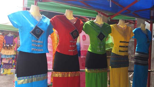 Colorful clothes at a market in Myanmar. Photo by Victor Block