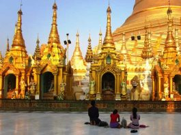Locals praying at a pagoda in Myanmar. Photo by Victor Block