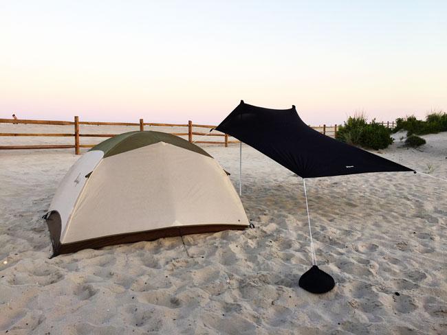 Setting up a two-man tent while camping at Assateague Island National Seashore.