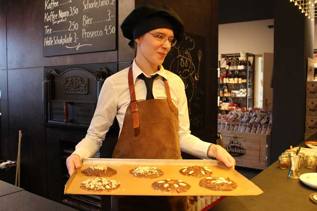 A baker at Wicklein Lebkuchen, one of Nuremberg's most famous gingerbread makers, shows us how to make gingerbread cookies. Photo by Janna Graber
