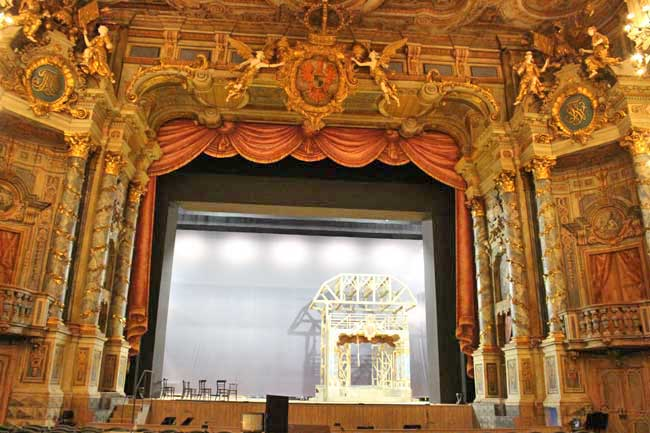 Workers set up the stage for a performance at the Margravial Opera House in Bayreuth, Germany. Photo by Janna Graber