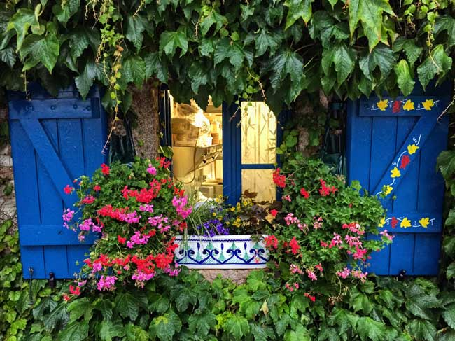 Brittany is filled with colorful flowers and charming homes. Photo by Rich Grant