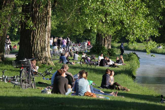 Locals enjoying the warm fall weather at the Englisher Garten in Munich, Germany. Photo by Sigi Mueller