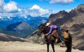 A horse packing trip in British Columbia offers adventure and incredible views. Photo by Tsylos Lodge
