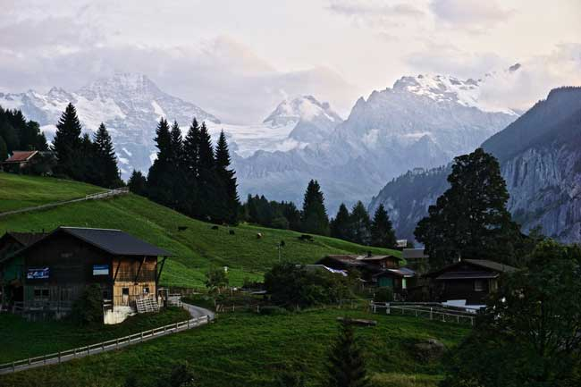 Hiking adventure in Switzerland. Watching daybreak from our terrace in Wengen