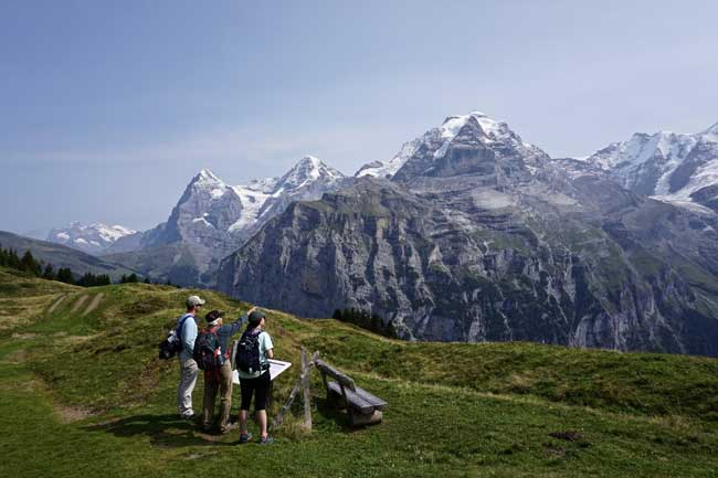 Hiking in Switzerland, and identifying Eiger, Monch and Jungfrau peaks above Murren.