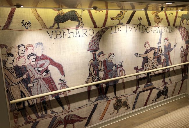 Replica of the Bayeux Tapestry on stairway wall. Photo by Claudia Carbone