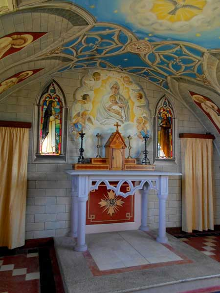 The frescoes and altar inside the chapel were crafted with loving attention and discarded materials. Photo by Carol L. Bowman