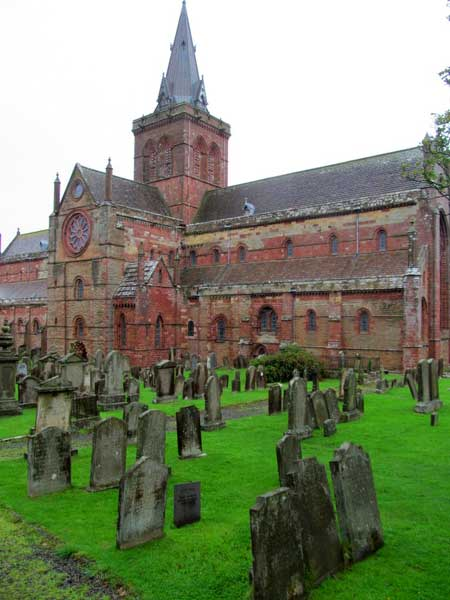 In Kirkwall, the magnificent St. Magnus Cathedral and the eerie cemetery dating back to the 1100's. Photo by Carol L. Bowman