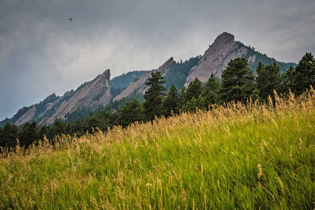 Boulder, Colorado is nestled below the Flatirons, a unique rock formation in the foothills of the Rocky Mountains. Flickr/Richard Schneider