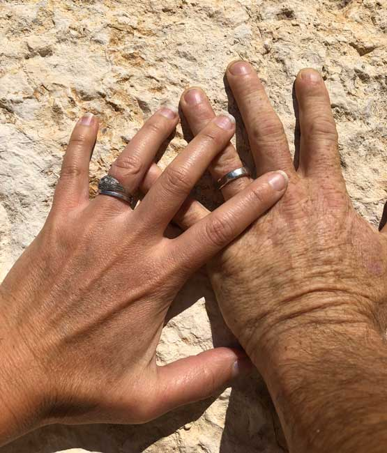 Wedding hands on ancient stone in Athens. Photo by Amber Turpin