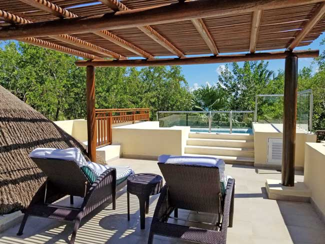 Lounging on the casita deck at the Fairmont Mayakoba, Riviera Maya. Photo by Carrie Dow
