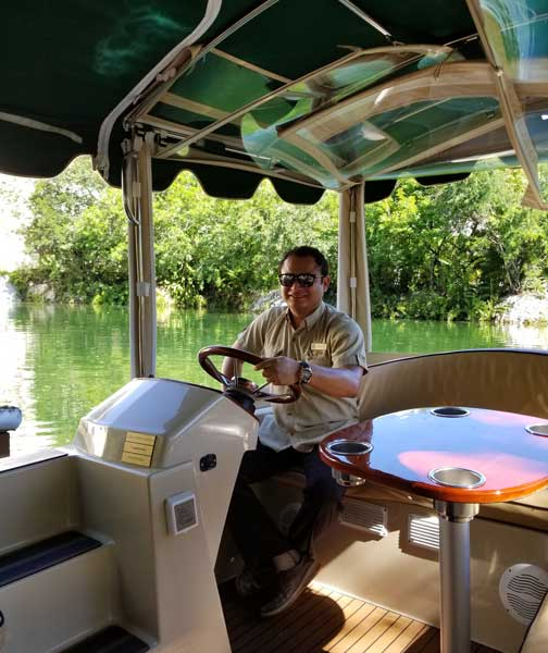 Francisco guides us on the nature boat tour at Fairmont Mayakoba. Photo by Carrie Dow