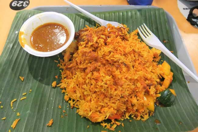 Dining on Biryani at the Tekka Centre in Little India, Singapore. Photo by Dan Morey