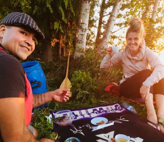 The author learns more about First Nations culture during the Great Spirit Circle Trail with Falcon, a tour guide and cultural coordinator. Photo courtesy Carri Wilbanks
