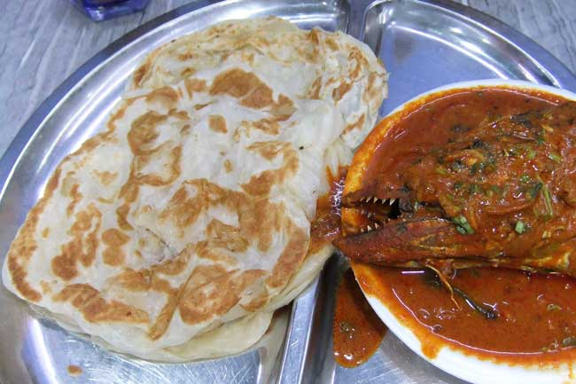 Prata, which comes from Chennai in southern India, is stretched, flipped, smeared with butter and fried. Photo by Dan Morey