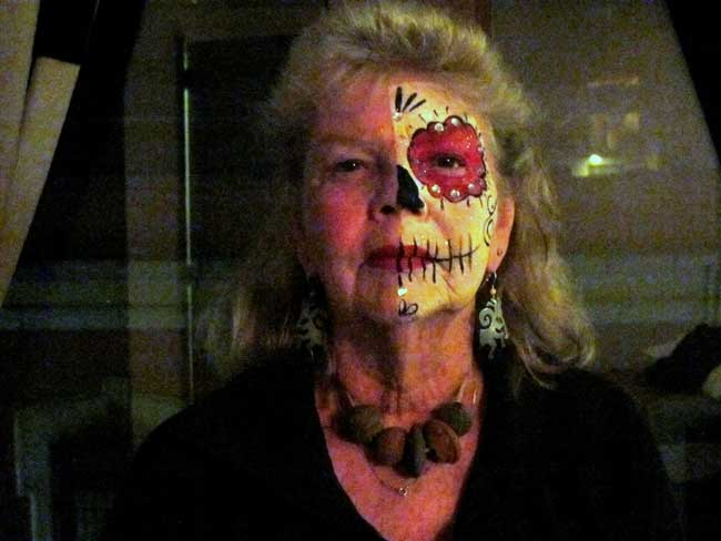 Author Carol Bowman opted for a medio-calavera painted face, because it honored both the living and the dead.