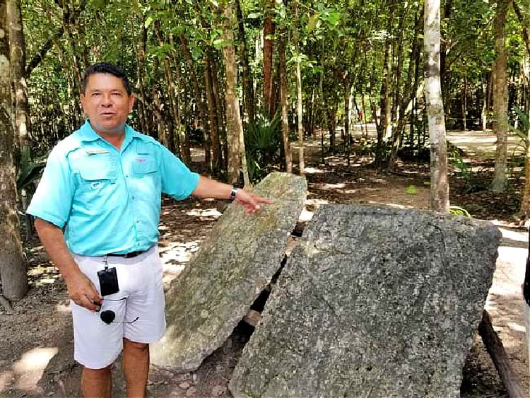 Our Coba, Mexico, guide Gamboa explains what is a stele.