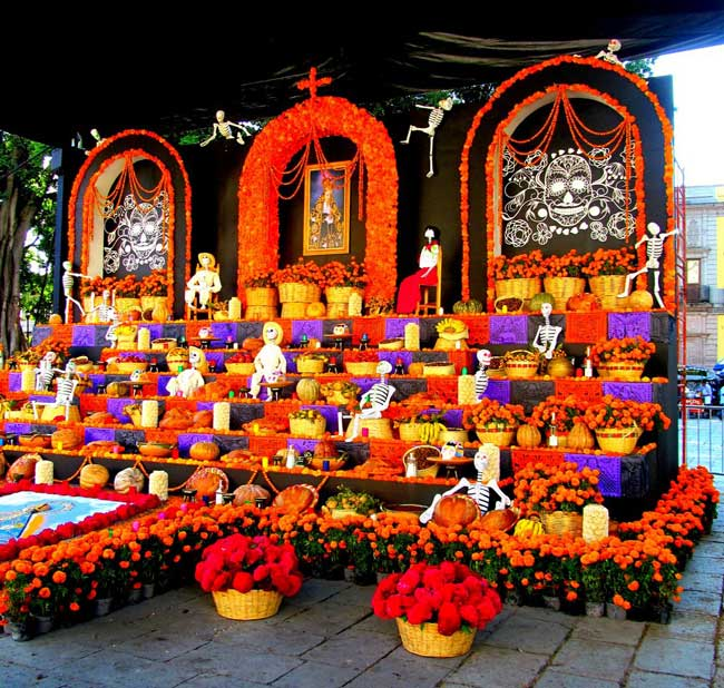 The public altars at Day of the Dead are dedicated to deceased dignitaries, and create an explosion of color. Photo by Carol L. Bowman