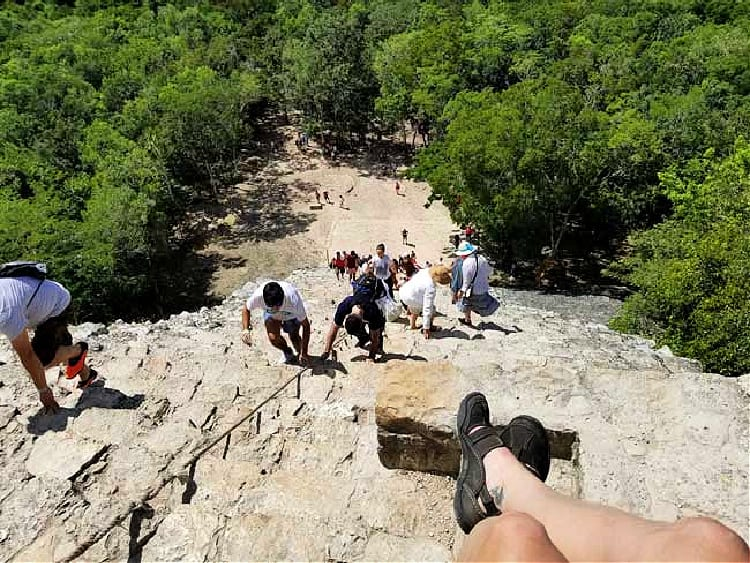 Climbing the Mayan ruins at Coba in Mexico. Photo by Carrie Dow