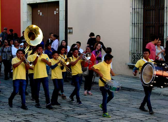 The streets around the Central Plaza of Oaxaca teem with non-stop parades, called calendas, each one proceeded by a brass band. Photo by Carol L. Bowman