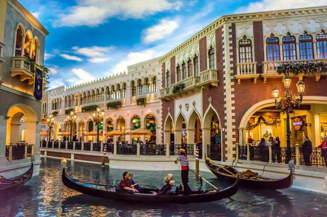 A hotel like The Venetian may seem touristy but strolling through this miniature Venice costs nothing — and the rooms are cheap as well.
