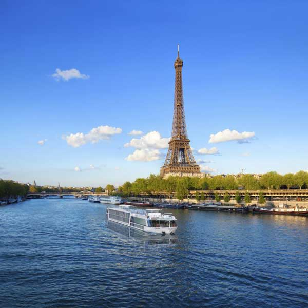 Adventures by Disney river cruises sail along the Seine River in Paris. Photo by Disney