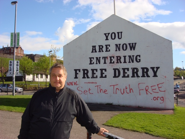"MPS standing in front of sign saying, ""You are now entering Free Derry"""
