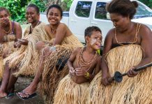 A Langalanga family, from Malaita Island, Ester, Margaret, Julie, and two siblings are members of the group who continue to make and use shell money, relax after demonstrating the process for visitors. Seen here in Mbokana Village, in Honiara, they come to the capital to sell shell money necklaces, and the ten-foot shell chains they use as barter and as a bride price. ©Steve Haggerty