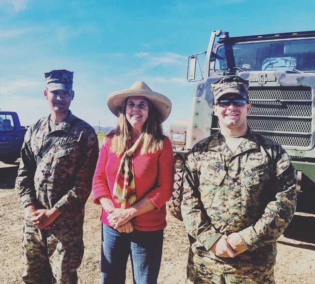 There are 100 Marines and Seabees repairing the runway at the Airport in the Sky. Photo of writer with two Marines.