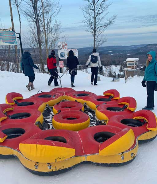 The author and her friends prepare to ride down on a 12-person raft at Super Glissades de Saint-Jean-de-Martha. Photo courtesy Janna Graber