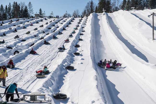Snow tubing runs at Super Glissades de Saint-Jean-de-Martha. Photo by Jimmy Vigneux