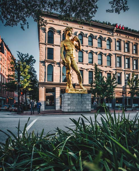 This eye-catching 30-foot-tall golden replica of Michelangelo's David stands outside the 21C Hotel on West Main Street in downtown Louisville. Photo by Go to Louisville