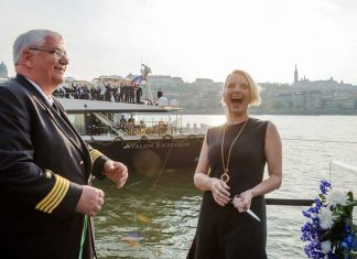 Author Elizabeth Gilbert, godmother of the Avalon Envision, laugh as she cut the ribbon with Captain Ralf Remus. Photo by Avalon Waterways