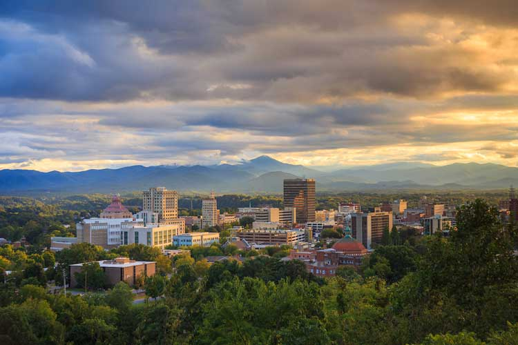 Sunset over downtown Asheville, North Carolina. Photo by ExploreAsheville.com