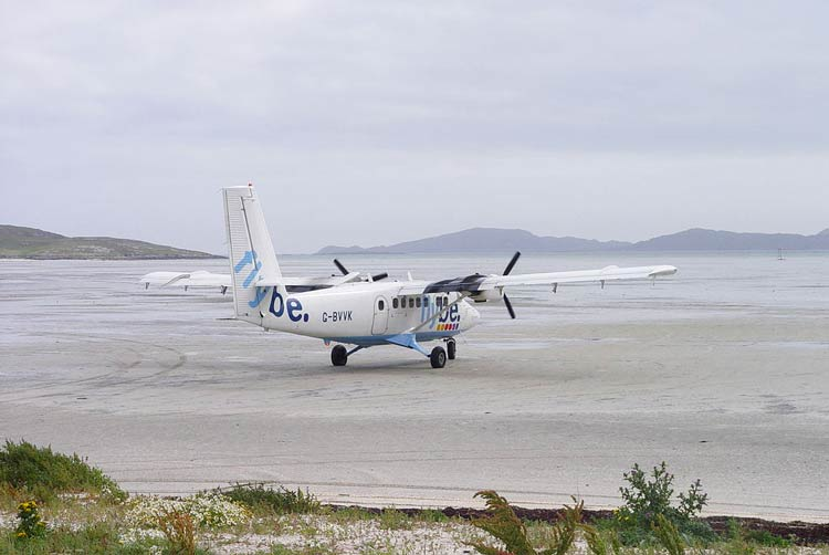 A plane landing on the beach at Barra Island.
