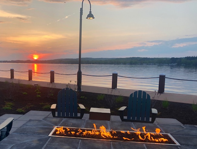 Relaxing at a lakeside fire pit. Photo by Claudia Carbone