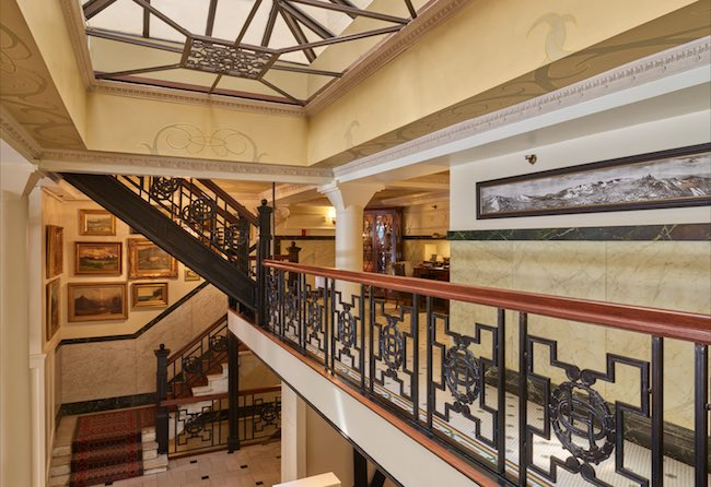 Original staircase railing with the OH logo. Photo courtesy of Oxford Hotel.