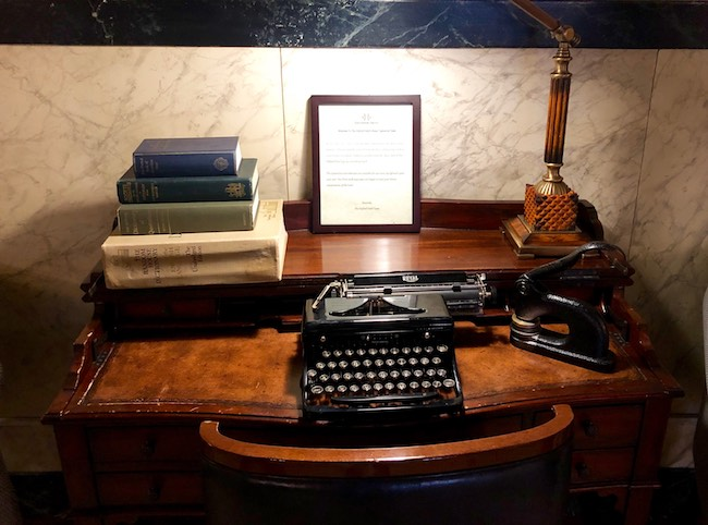 Desk with old typewriter and embosser on the second floor. Photo by Claudia Carbone