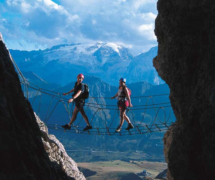 Via ferrata route in the Dolomoties with suspended bridge. Photo by Herbert Summerer