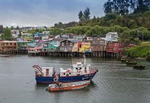 """Palafitos"", wooden stilt houses, some centuries old, line the west shore of Fiordo de Castro bay, Chiloé, Chile. ©Steve Haggerty/ColorWorld"