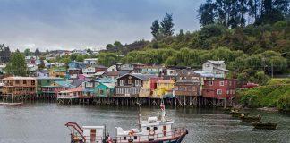 """Palafitos"", wooden stilt houses, some centuries old, line the west shore of Fiordo de Castro bay, Chiloé, Chile. ©Steve Haggerty/ColorWorld"