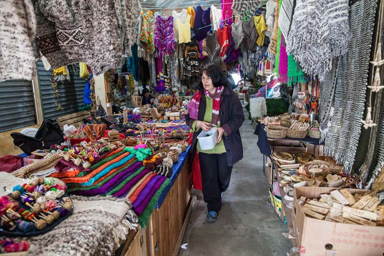 Feria Artesanal (artist's market) in Dalcahue is the place to buy hand-knit woolen shawls and wood carvings, Chiloé, Chile. ©Steve Haggerty/ColorWorld