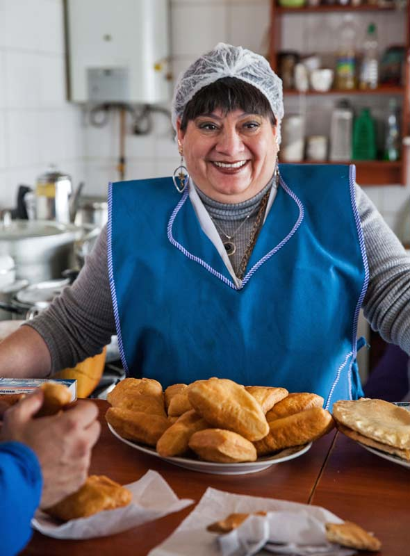 Cheerful smiles and just-baked pastries welcome visitors to the Castro market, Chiloé, Chile. ©Steve Haggerty/ColorWorld