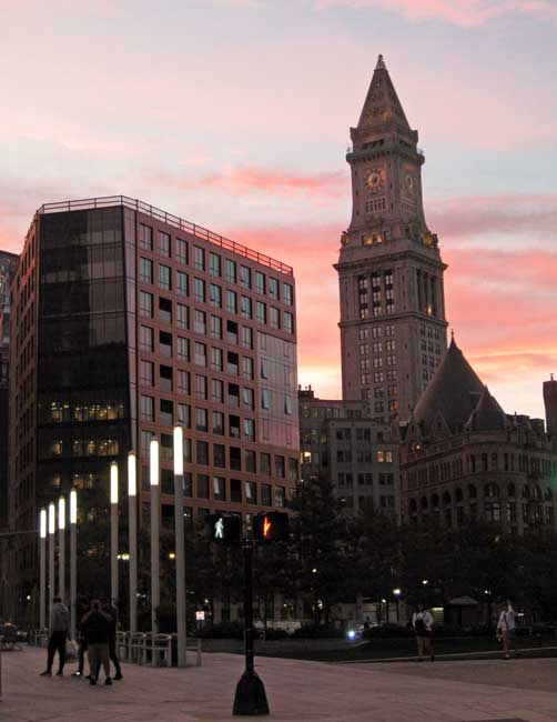 Sunset view of the Custom House clock tower in the Financial District.